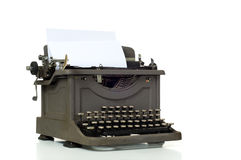Vintage Typewriter. On white background with space for copy on the paper Royalty Free Stock Photo