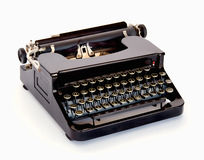 Vintage Typewriter. Vintage 1940 black typewriter on white background Stock Image