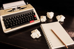 Vintage typewriter and a blank notebook of paper Stock Photo