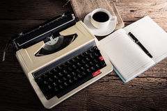 Vintage typewriter and a blank notebook , pen and coffee cup Royalty Free Stock Photography