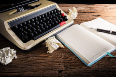 Vintage typewriter and a blank notebook and pen Stock Photo