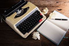 Vintage typewriter and a blank notebook and pen Stock Image