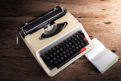 Vintage typewriter and a blank notebook and pen Stock Images