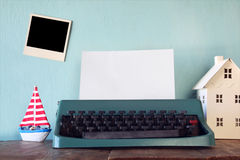 Vintage typewriter with blank page and empty photo frame Royalty Free Stock Images