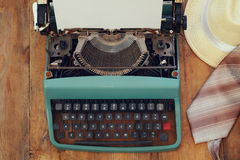 Vintage typewriter with blank page on wooden table Royalty Free Stock Photo
