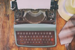 Vintage typewriter with blank page on wooden table Stock Images