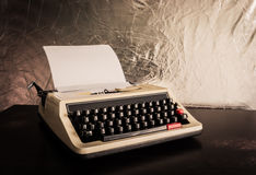 Vintage typewriter and a blank paper Stock Photo