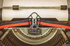 Vintage typewriter with a blank paper sheet Royalty Free Stock Images