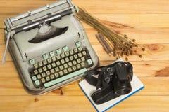 Vintage typewriter and camera Stock Image