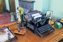 Vintage Typewriter and Candlestick Telephone. 1930s office desk with typewriter and candlestick telephone together with other items from that time. This desk is Stock Image