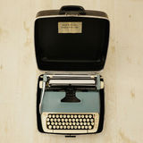 Vintage typewriter. A vintage typewriter in carry case Stock Images