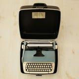 Vintage typewriter. A vintage typewriter in carry case stock images