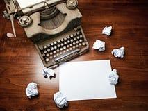Vintage Typewriter covered desk blank white sheet copy space Stock Photo