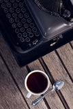 Vintage typewriter and cup of black coffee Stock Photography