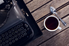 Vintage typewriter and cup of black coffee Royalty Free Stock Photography