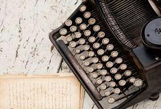 Vintage typewriter with Cyrillic letters on the buttons and notebooks with the text Royalty Free Stock Images