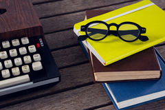 Vintage typewriter, diary and spectacles on wooden table. Close-up of vintage typewriter, diary and spectacles on wooden table Stock Images