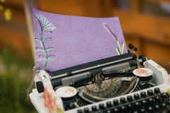 Vintage typewriter with fancy paper Royalty Free Stock Photography