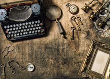 Vintage typewriter golden frame old office accessories wooden ta royalty free stock photos