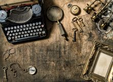 Vintage typewriter golden frame old office accessories wooden ta Stock Photos