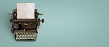 Vintage typewriter header with old paper. Retro machine technology - top view and creative flat lay design stock image