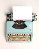 Vintage typewriter. Image of an old cyan vintage typewriter, beat around the edges Royalty Free Stock Images