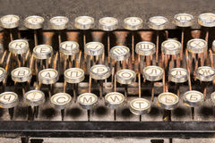 Vintage typewriter keyboard. Old dirty rusty vintage typewriter keyboard with Russian alphabet Stock Photos