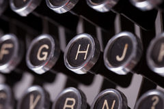Vintage typewriter keys. Macro on white background Royalty Free Stock Images