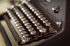 Vintage Typewriter Keys Selective Focus. Vintage typewriter keys covered in dust. Selective focus stock photos