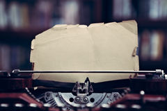 Vintage typewriter in a library royalty free stock photos