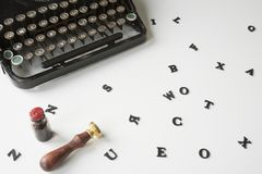 Vintage typewriter with messy letters on white desk royalty free stock image
