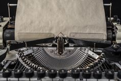 Vintage typewriter with an old blank sheet of paper mock up. Objects to accommodate your design Stock Photography