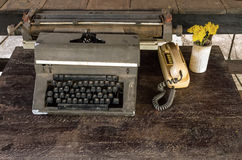 Vintage typewriter, old classic telephone and dry chrysanthemum Royalty Free Stock Images