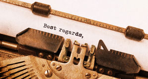 Vintage typewriter. Old rusty, warm yellow filter, best regards royalty free stock photography