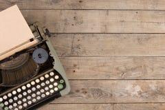Vintage typewriter on the old wooden desk Stock Photos