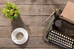 Vintage typewriter on the old wooden desk Royalty Free Stock Photo