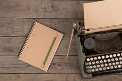 Vintage typewriter on the old wooden desk Royalty Free Stock Photography