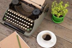 Vintage typewriter on the old wooden desk Stock Images
