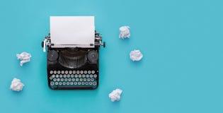 Vintage typewriter over blue background Stock Photos