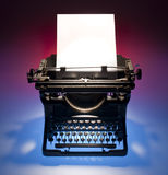Vintage typewriter and paper. Old fashioned, vintage typewriter with a blank sheet of paper inserted Stock Images
