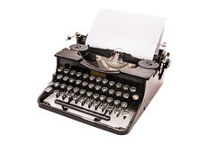 Vintage typewriter. With paper sheet isolated on white Royalty Free Stock Image
