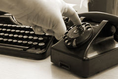 Vintage typewriter and phone Stock Images