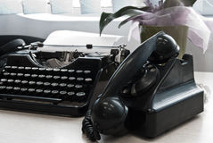 Vintage typewriter and phone Stock Photos