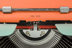 Vintage Typewriter. With Phrase THE END Typed in Orange Paper Stock Photo