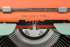 Vintage Typewriter. With Phrase 'Once upon a time...' Typed in Orange Paper stock photos