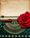 Vintage typewriter red rose flower. Grungy paper Stock Photos