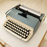 Vintage typewriter. A vintage typewriter on table Royalty Free Stock Photos