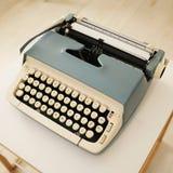 Vintage typewriter. A vintage typewriter on table royalty free stock photos
