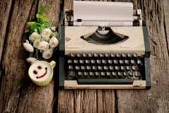 Vintage typewriter and telephone , notebook on the wood desk in Stock Photography