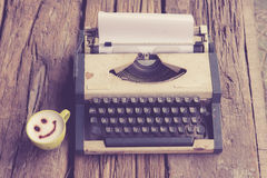 Vintage typewriter and telephone , notebook on the wood desk in Stock Photos